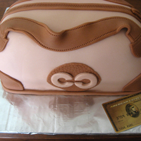 Purse Cake My SIL loves to shop so I made her a Coach purse for her birthday. Everything is edible except for the American Express card (it's an...