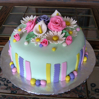 Flower Birthday Cake - Easter Theme This was a birthday cake for someone who loves flowers and gardening. Her birthday is close to Easter so we combined everything. These were...