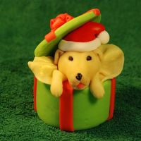 Christmas Pupcake I made the decorations with fondant and modeling chocolate