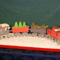 Santa's Christmas Train This is my favorite cake I have ever made so far. It is a chocolate cake with butter cream and covered with modeling chocolate. I had a lot...