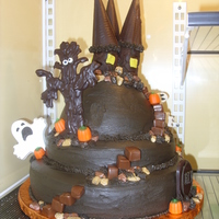 Haunted Castle 3 tier haunted castle... all edible. Tree is stacked marshmallows covered in chocolate, towers are tootsie rolls (3 large) rolled with dark...