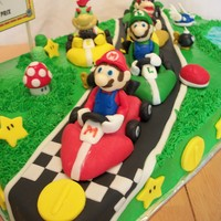 Mario Kart Birthday Cake This is a 1/2 vanilla sheet cake for a boy turning seven. Mario Kart characters included are Mario, Luigi, Diddy Kong, Bowser Jr., and...