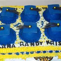 6 Graduates Made for an office that was celebrating 6 graduates. I saw a similar cake here in cc.