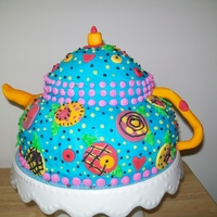 Tea Pot Cake Made for my sister-in-laws 40th birthday! She is a Big Mary Englebreit fan so I adapted one of her patterens for this cake! Strawberry...