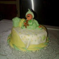 Baby  this was a simple cake made for a small baby shower. This was actually my first fondant sculpture. the baby is holding a teddy bear, with...