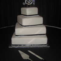 Bling White fondant with black ribbon and bling.
