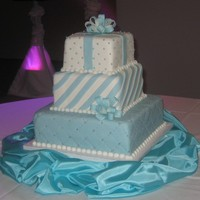 Whimsical Square cakes, fondant icing in turquoise and white. Gumpaste bow.