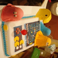 Pacman An old-school arcade inspired cake for a birthday. The cake is all Golden Butter cake, the Ghosts and arcade are covered in home-made (NOT...