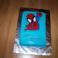Spiderman Half sheet cake with Spiderman cake on top.