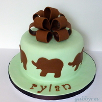"Green & Brown Elephant Boy Baby Shower Homemade marshmallow fondant. Fondant accents. White cake with buttercream. 8"" and 4.5"" tall. For a baby boy named Rylan, yes..."
