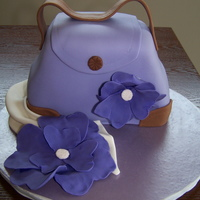 Purple Purse With Fantasty Flowers I did this cake for a woman's 50th birthday. I was told the birthday girl loved purses, purple, and flowers - so this is what I came...