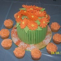 Spring Bouquet My version of the bouquet cake. Orange Gerber Daisies with matching cupcakes. Lemon cake with Lemon Buttercream filling. TFL!