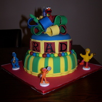 Sesame Street Cake Birthday cake for a 2-year-old boy named Brady (hard to tell tell because name wraps around the cake). Client provided the figurines and...