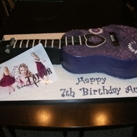 A Taylor Swift Fan Marble cake for the guitar with chocolate buttercream, marble cake for the guitar arm with creamcheese buttercream. Fondant covered and...