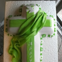 Confirmation Cake White Cake with raspberry buttercream filling, covered & detailed in Fondant. Lime green is Abbey's favorite colour.