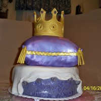 Hb To Tthe Queen first pillow cake. All ediable with Fondant and sugarpaste. Jewels on crown are jellybeans.