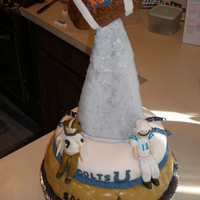 Superbowl Xliv Saints layer-yellow cake with strawberry filling, Colts layer-devil's fod with almond filling all with buttercream icing and fondant....
