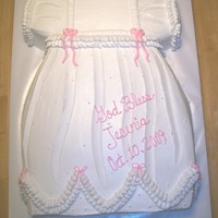 Baby Gown this gown is made from a 11x15 cake, is shaped and then iced with buttercream icing. is the decorate with piped icing for the ruffles, and...