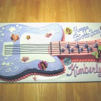 Hanna Montana Guitar Cake every little girl loves Hanna Montana, and this guitar cake is bright and colorfull. its made out of 11x15 cake and a 9x13. it s...
