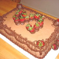 Choolate Grooms Cake With Strawberries this is a double layer, 12x18 chocolate grooms cake with chocolate butterbream, chocolate covered strawberries, and chocolate drizzle and...