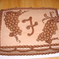 Grooms Cake With Grapes this is a 11x15 chocolate grooms cake with chocolate buttercream and fudge boarders. the grapes are made using Whoppers Malted Milk Balls,...