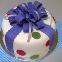 Present Cake This was the first cake i tried out of class. I made this for my niece who is a mad dockers (australian football) fan hence the purple red...