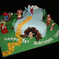 In The Night Garden Number 1. Customer supplied the figurines but this cake was a lot of fun to make. Cake is white raspberry mud and covered in fondant.