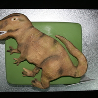 T-Rex Customer bought me in a picture to copy of this T-Rex for his girlfriend who is dino crazy. The cake underneath is Choc mud and the dino on...