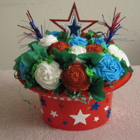 Hooray For The Red, White & Blue! Cupcake bouquet for 4th of July. The container is a plastic hat. There are 9 regular-size cupcakes with 9 mini-size cupcakes. Strawberry...