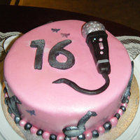 Sweet 16 Birthday whit mud cake with Italian butter cream and fondant , made for a young singer..By Jen