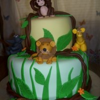 Baby Shower Jungle Baby shower jungle themed cake. Two layer chocolate cake with butter cream icing covered with marshmellow fontant. My first attempt ever to...