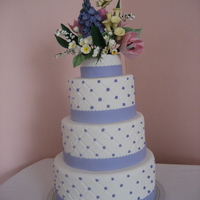 Spring Wedding Fondant covered cake with hand made gum paste spring flowers.