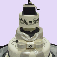 Black And White Wedding Cake Gramaphone made in gumpaste. Sugar rocks are from Crystal Candy found at Kings supermarket. They are wonderful to use and dont loose their...