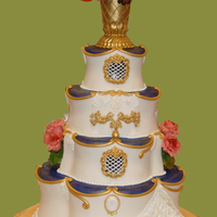 Elegant Wedding Cake With Blue And Gold Accents All in fondant and gumpaste peonies and flowers