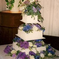 Basket Weave Wedding Cake   Buttercream icing. Real flowers. Very large cake. One of my first wedding cakes.