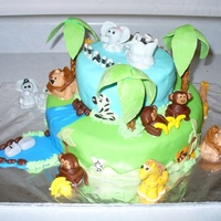 Jungle Baby Shower Cake everything is made out of fondant. The cakes on CC were a great source of inspiration.TFL