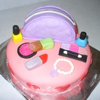 Makeup Cake birthday cake for my 6 year old who wanted a makeup party. Cake is covered in jello MMF, all decorations made out of MMF.TFL