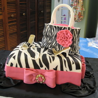 Zebra, Purse And Shoe Quincea?era Cake My first Quincea?era cake. The humidity and hot weather in Puerto Rico make my work a lot difficult, but I pleased with the results. Sorry...