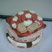Ashley's Baby Shower Cake Bottom layer is red velvet with cheesecake mousse filling, middle layer is french vanilla vake with white choclate mousse filling, top is...