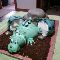 Baby Dragon Cake All MFF fondant. Each section of the cake is a different flavor of cake..mountain is pineapple cake with crushed pineapple filling, dragon...