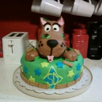Scooby Doo Busting Out Cake was milk chocolate with orea cream filing. All covering and accents are MMF. Scooby himself is RKT with MMF covering. The cookies are...