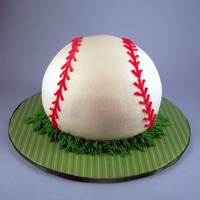 Baseball Cake This was my first ball cake. It was made for my bosses birthday who is a BIG baseball fan. The cake is a vanilla WASC cake. It is frosted...