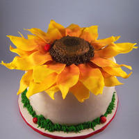 Sunflower With Ladybugs This was made as a birthday cake. It was my first time using gumpaste and i will have to say i learned a lot The petals and ladybugs are...