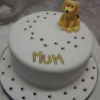"Spot The Dog Spot the dog cake for my mum. 8"" lemon cake. dog is fondant and tylo. the muddy paw prints and the word mum are hand painted. TFL"