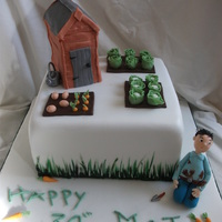 Allotment/garden this is a square cake. an allotment /garden scene. all items are hand made and everything is edible. the shed is made from cake, hand...