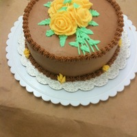 Wilton Course I Cake Chocolate Buttercream, vanilla cake with caramel filling. Yellow roses piped using Wilton method.