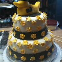 Ducky Graduation 2010 Checkerboard Cake, MMF, Royal Icing flowers with pearls. Duck is made from candy clay. Small gum paste camera on the duck, and the final...