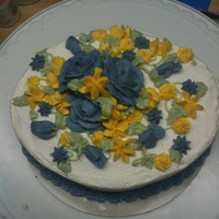 Blue And Yellow Flowers Chocolate and Vanilla Layers, Buttercream icing, piped buttercream flowers in yellow and blue. Just cause cake for practice.