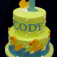 Rubber Ducky Cake is covered in fondant. Decorations are gumpaste and cut out with the cricut cake. This cake was recently featured in Modern Baking...