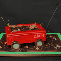 My Little Red Wagon What says boy more than sticks, a wagon, rocks, mud, and dirt.